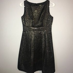 Sparkly black dress with gold tone